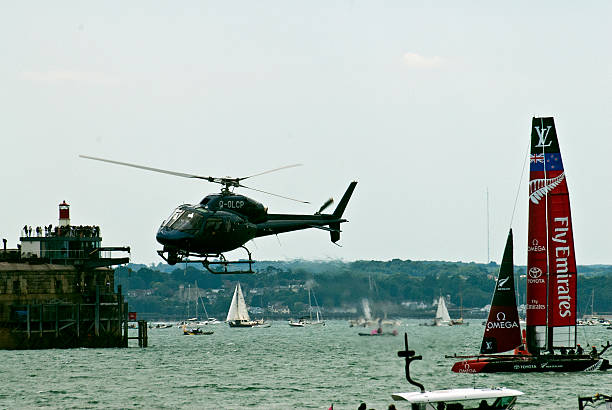 Helicopter filming the America's Cup in Portsmouth. stock photo