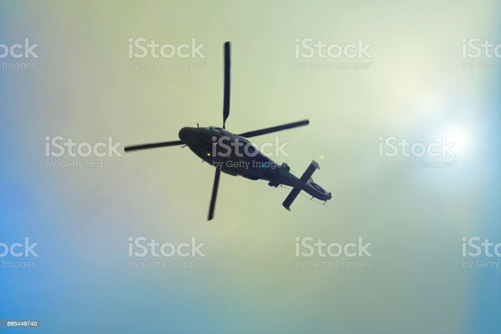 Helicopter flying in the blue sky foto de stock royalty-free