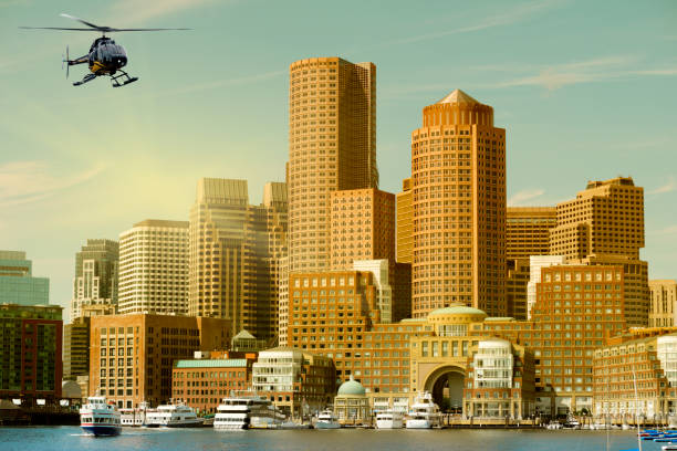 Helicopter flying over Boston, Massachusetts, USA stock photo