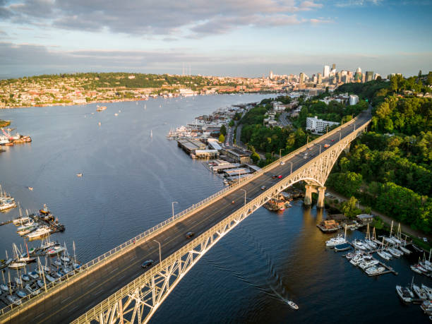 Helicopter Flying Over Famous Bridge in Pacific Northwest on Sunny Day stock photo