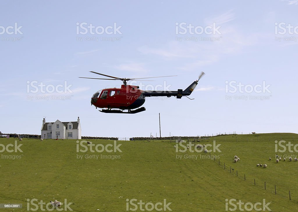 Helicopter flying over farmland royalty-free stock photo