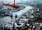 Helicopter Flying over Tower Bridge, London, UK.