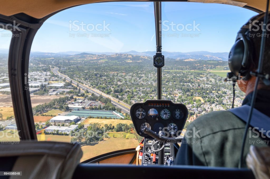 Helicopter flying town in Napa Valley, California stock photo