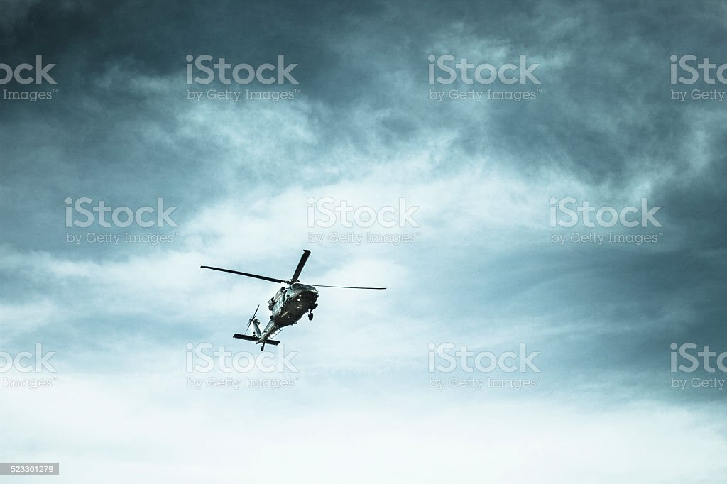 Helicopter in a Stormy Sky stock photo