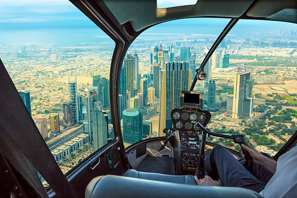 Helicopter In Dubai Downtown Stock Photo