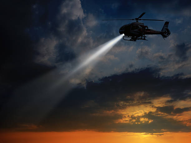 Helicopter in dusk stock photo