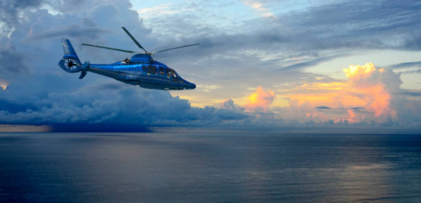 Helicopter in Front of a Thunderstorm Over the Atlantic Ocean at Sunrise stock photo