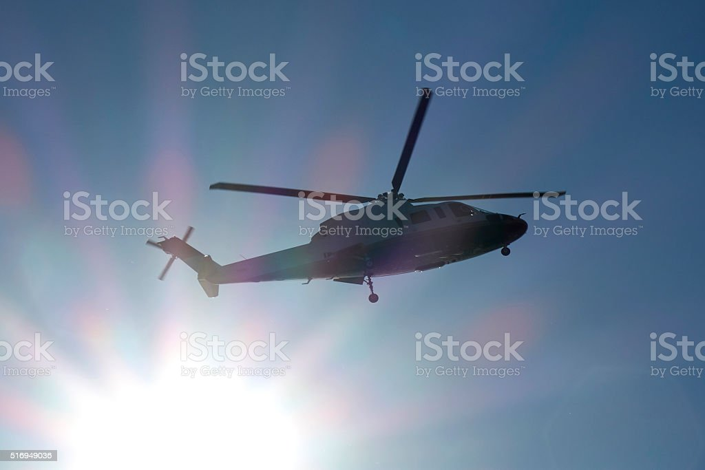 Helicopter in mid-air stock photo