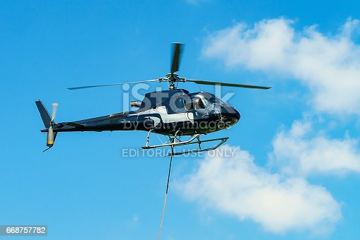 Lavaux, Switzerland - August 30, 2016: Helicopter in the sky at Lavaux, Lavaux-Oron district, Switzerland