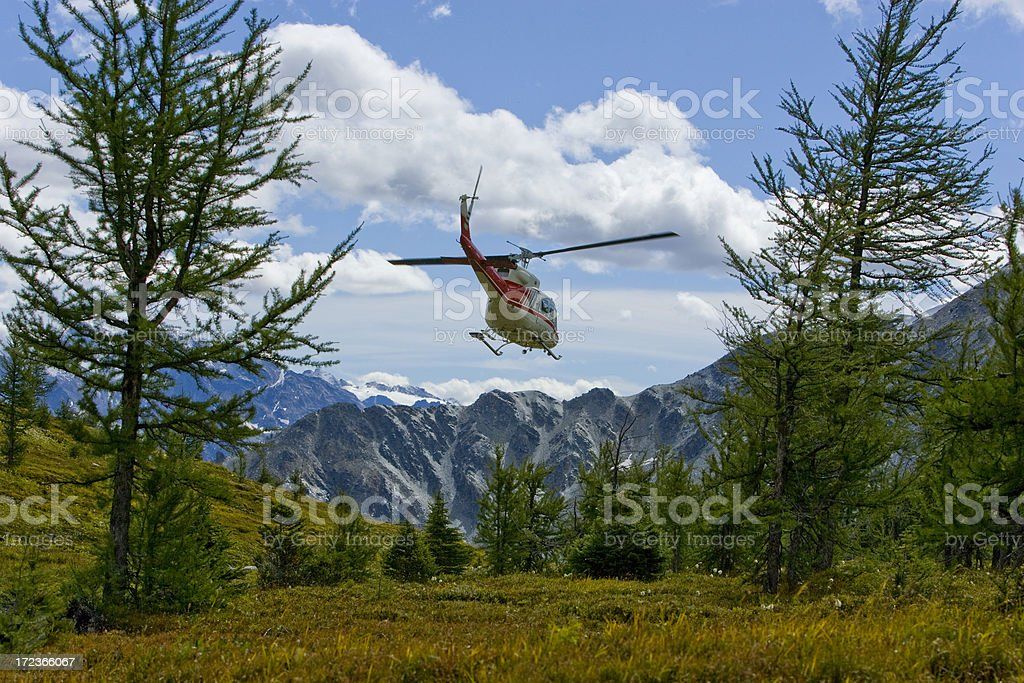 helicopter in the high alpine stock photo