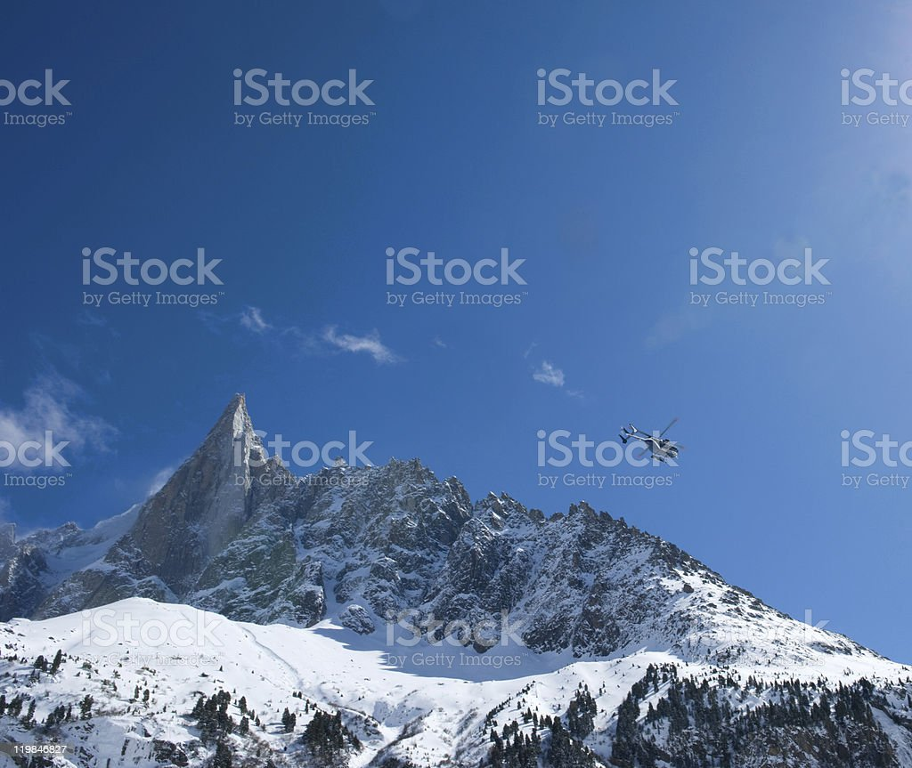 Helicopter in the mountains royalty-free stock photo
