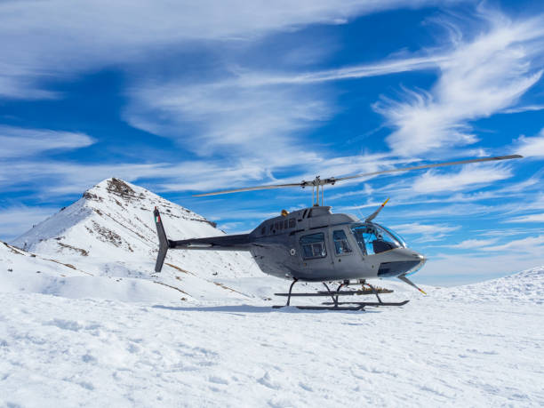Helicopter in the mountains stock photo