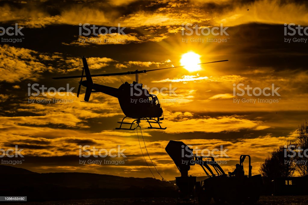 Helicopter in the sunset stock photo