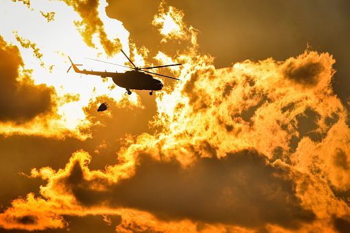 Dramatic footage of a helicopter flying into a burning flames