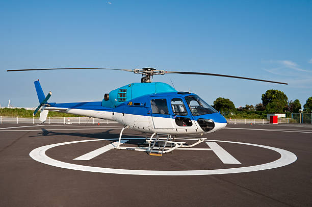 Helicopter landed at a heliport stock photo
