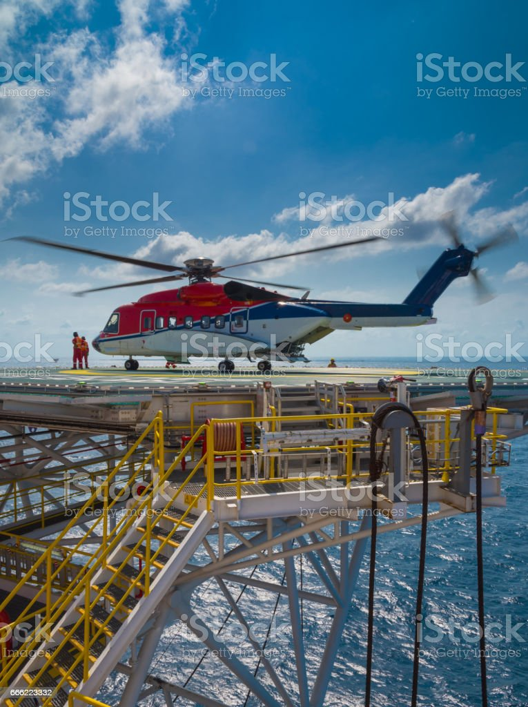 helicopter landed on offshore drilling rig stock photo