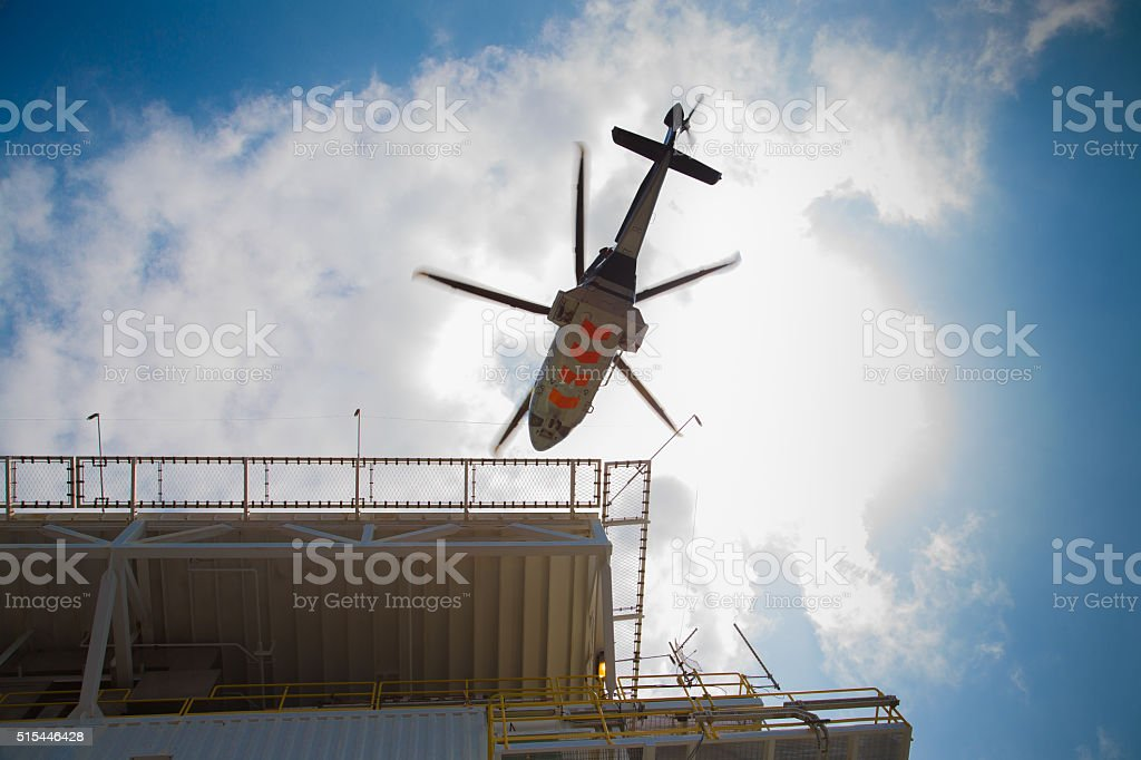 Helicopter landing at helicopter deck  oil and gas industry,offshore. stock photo