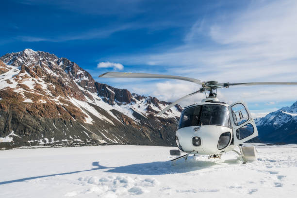 Helicopter Landing on a Snow Mountain stock photo