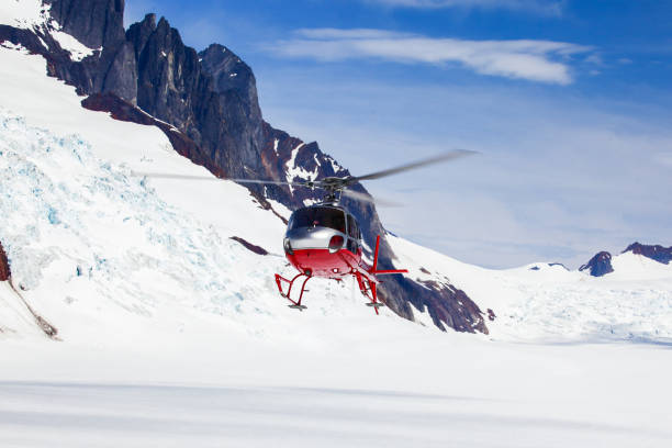 Helicopter Lands on Glacier stock photo