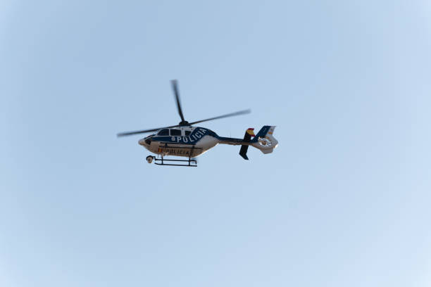 Helicopter of the Spanish national police, model Eurocopter EC 135P2 +, in surveillance tasks during the confinement by Covid-19 stock photo