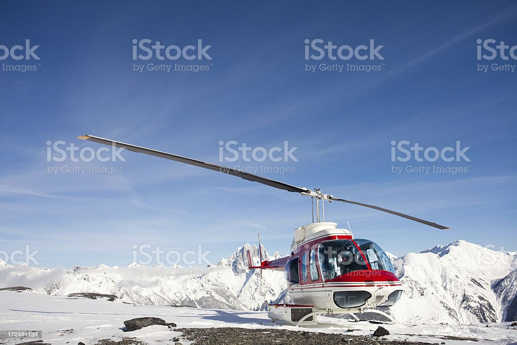Helicopter on a Mountain in Winter royalty-free stock photo