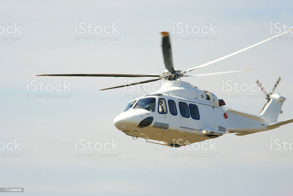 Helicopter on air on a cloudy day stock photo