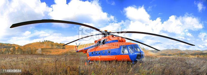 istock Helicopter on the background of the autumn landscape 1149049534