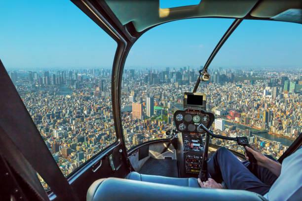 hubschrauber auf tokio - flugzeugperspektive stock-fotos und bilder