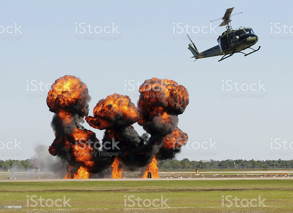 Helicopter over fire royalty-free stock photo