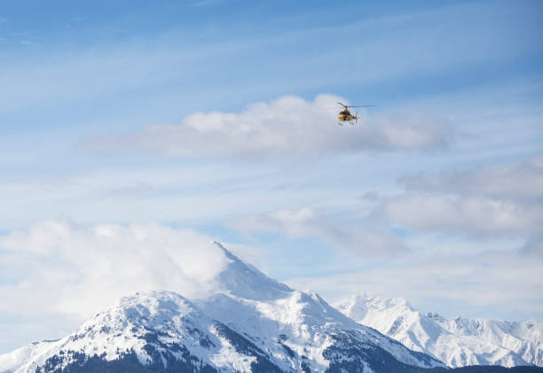 Helicopter over mountains stock photo