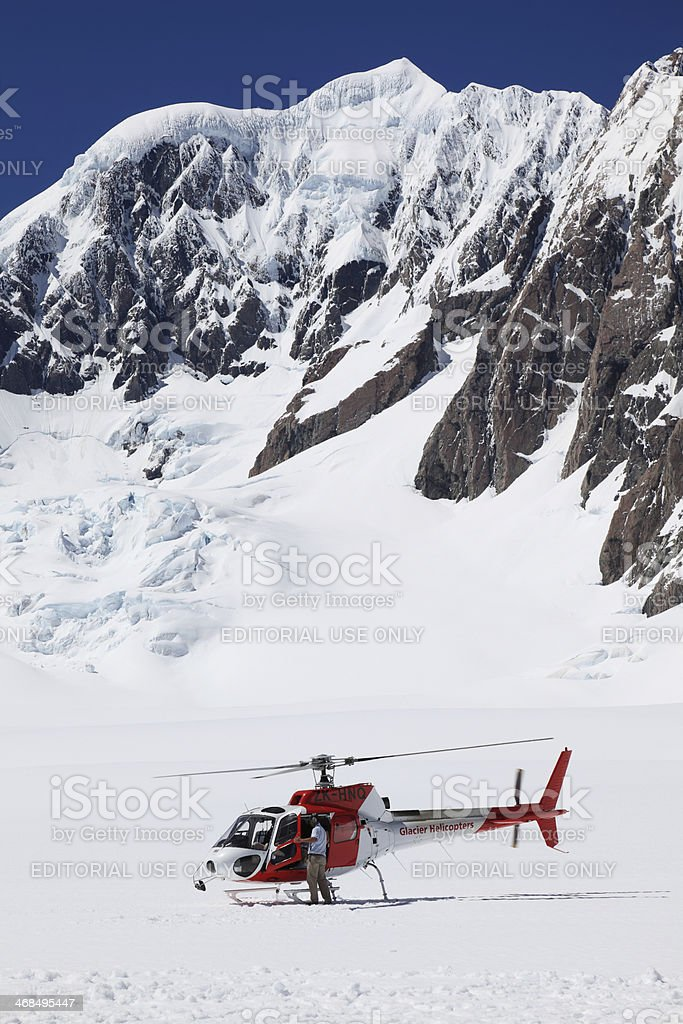 Helicopter parked on Fox Glacier stock photo