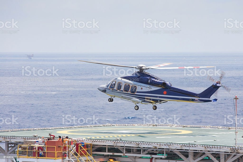 Helicopter parking at an offshore oil and gas platform stock photo