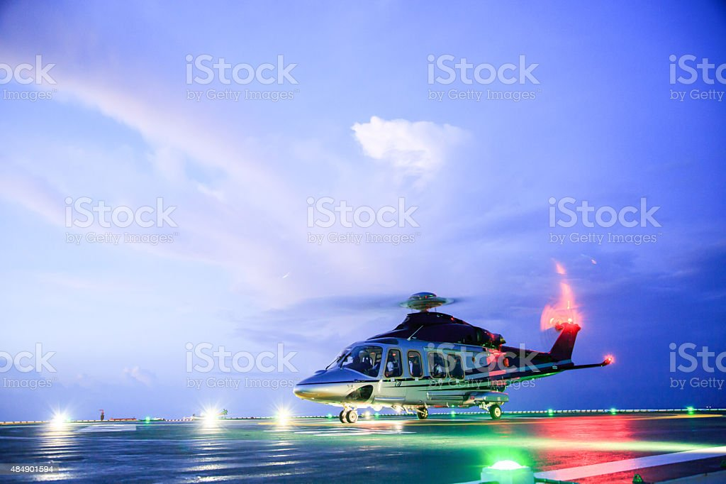 helicopter parking landing on offshore platform. Helicopter transfer crews stock photo