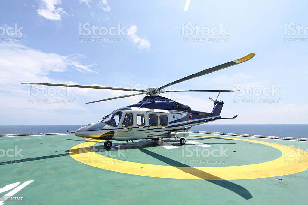 helicopter parking landing on offshore platform stock photo