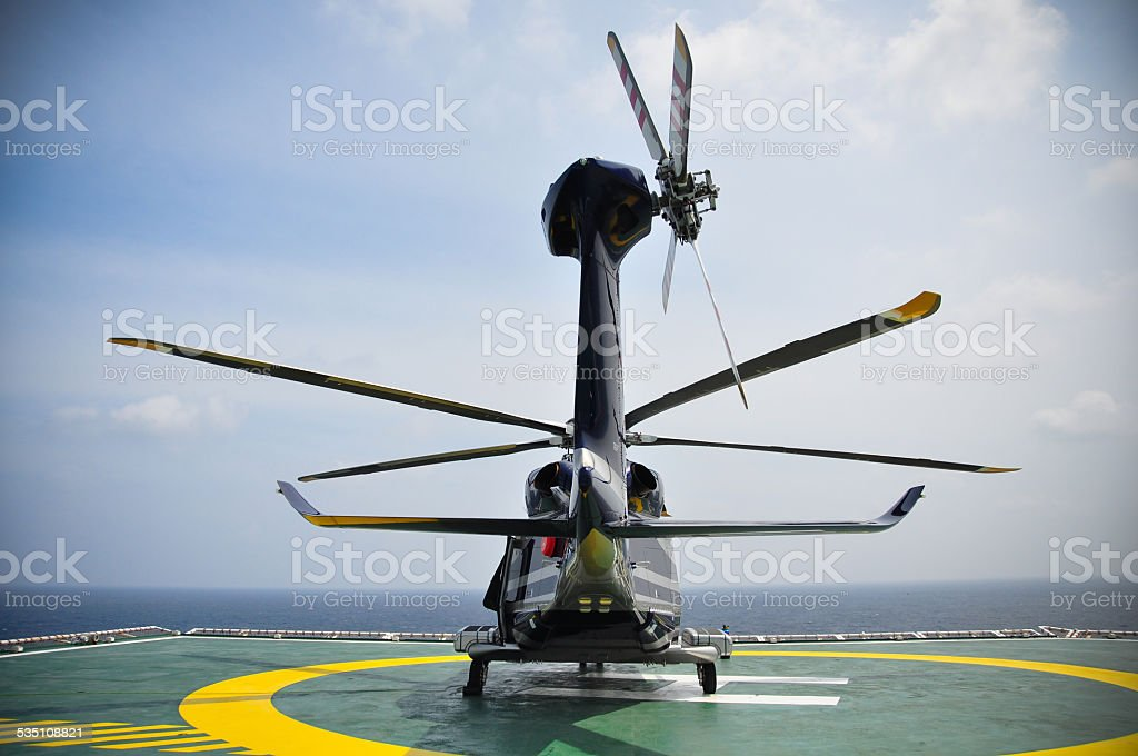 Helicopter parking on helideck and waiting passenger stock photo