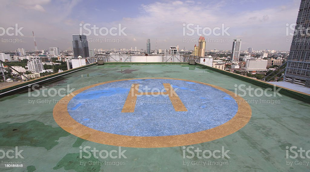Helicopter parking on roof of tower stock photo