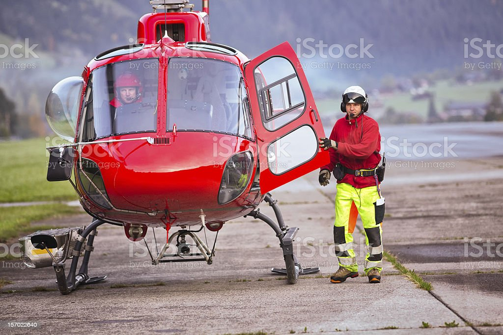 Helicopter pilot keeping door open royalty-free stock photo