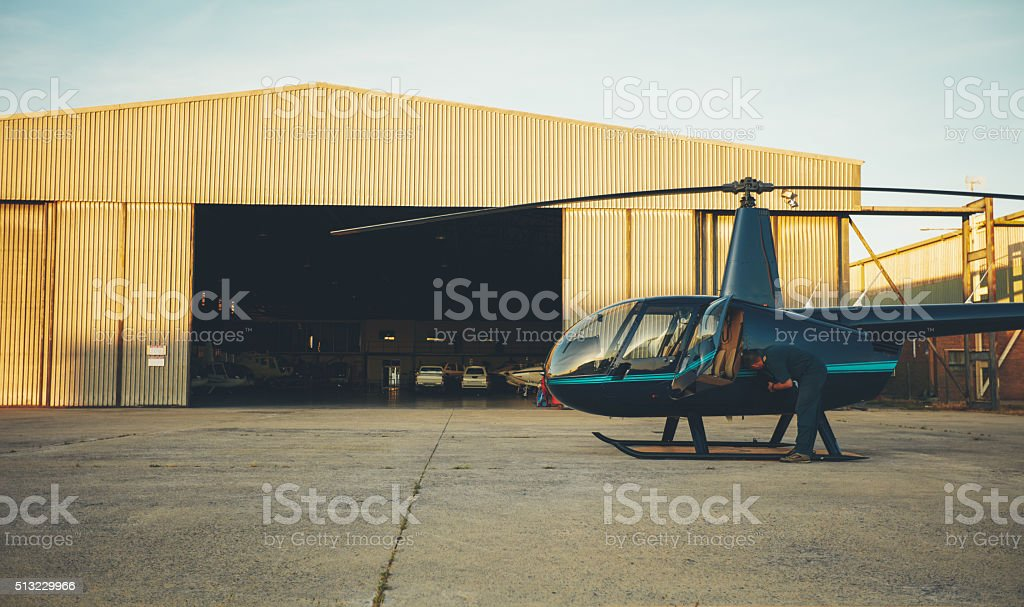 Helicopter pilot preparing for a flight stock photo