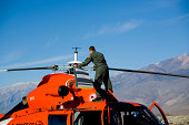 """""""Coast Guard Crew Chief performs preflight check on French made helicopter.  Eurocopter Dauphin helicopter, top speed 165 knots.  Click on an image to go to my Fire Fighters and Paramedics Lightbox."""""""