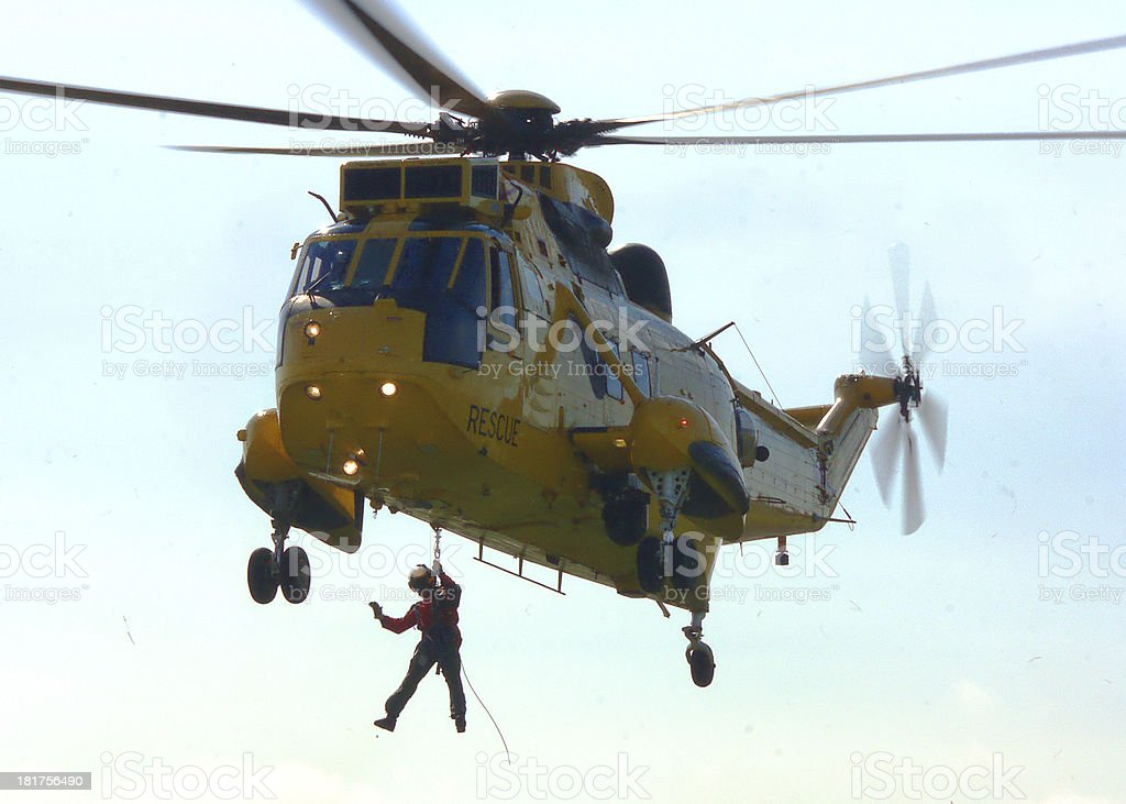 Helicopter rescue crew winches down stock photo