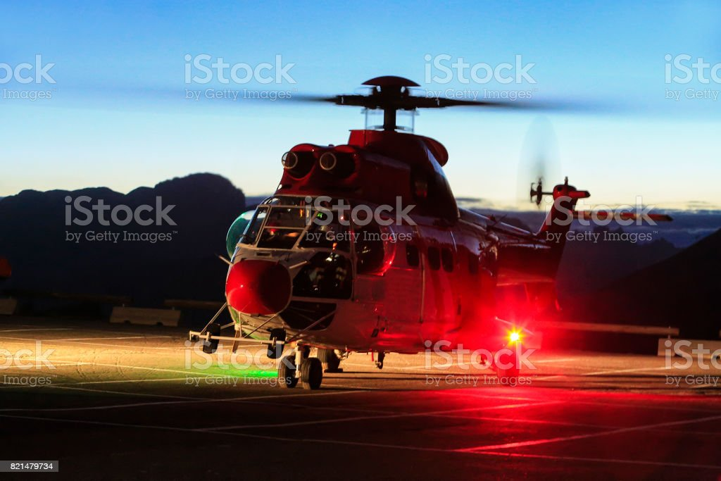 Helicopter rescue, Red rescue helicopter to intervene in the saddle in the Dolomites. Passo Pordoi. stock photo