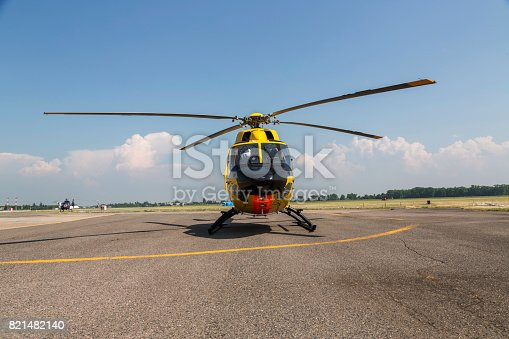 istock Helicopter rescue. Yellow helicopter on runway.  All logos and text removed. 821482140