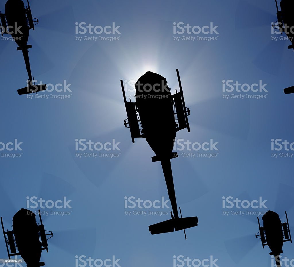 Helicopter silhouette in the sky stock photo