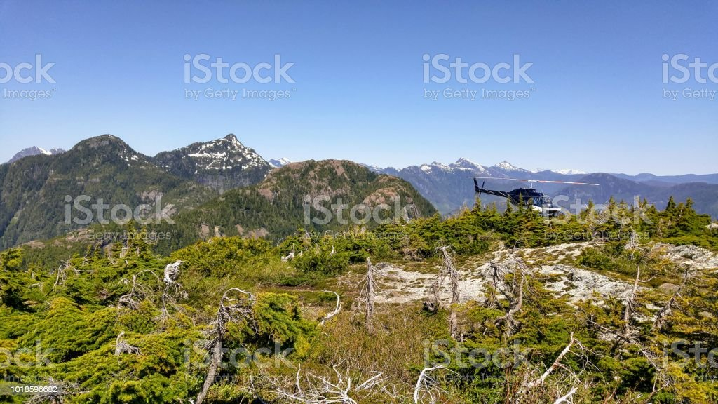 A helicopter sits on top of a mountain on the west coast of vancouver island stock photo