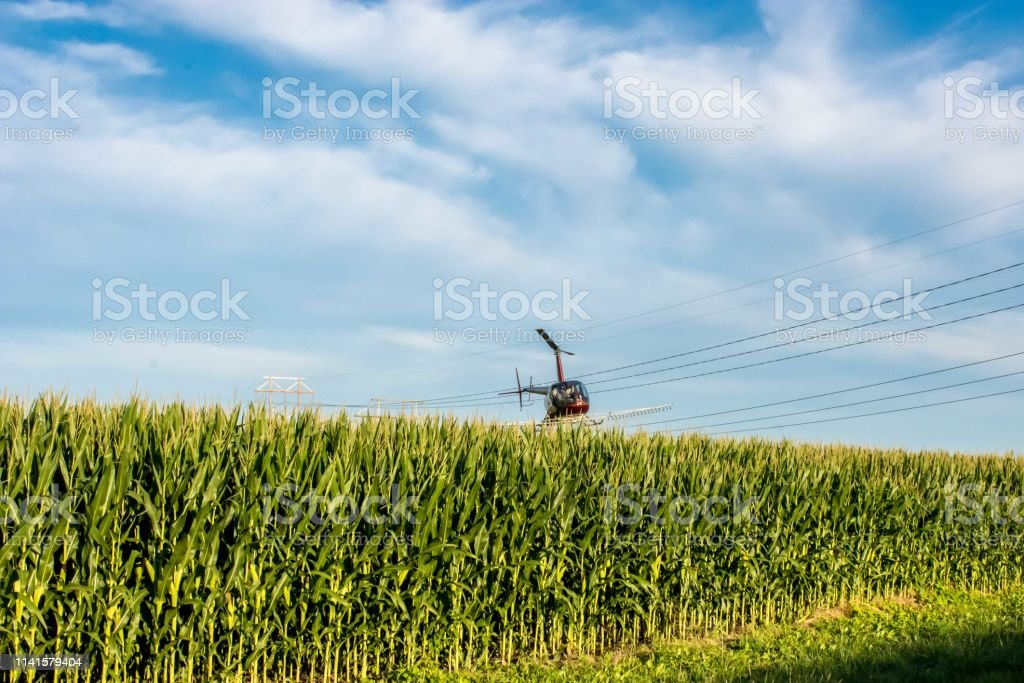 A helicopter sprays cops in the midwest stock photo