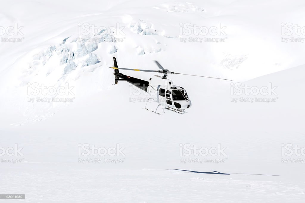 Helicopter Taking Off from Mountain Top stock photo