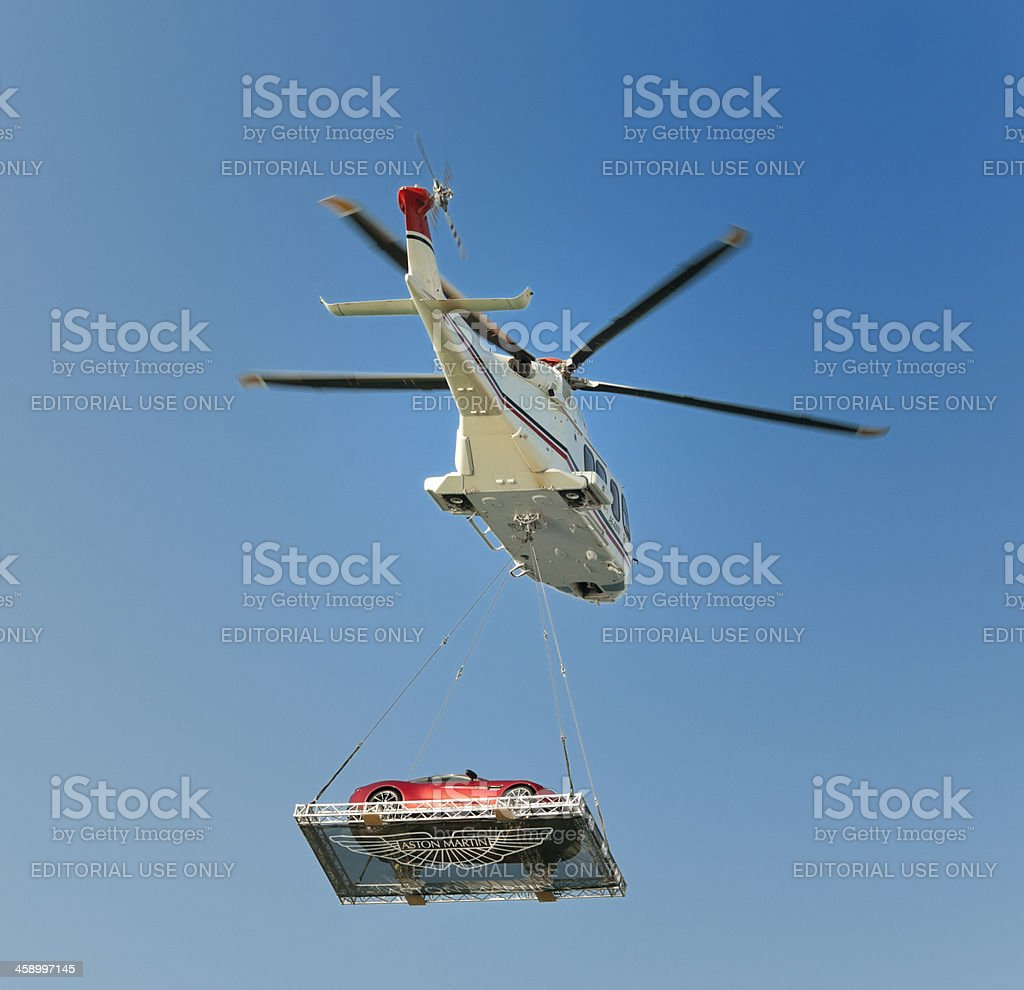 helicopter transporting Austin Martin Vanquish sports car stock photo