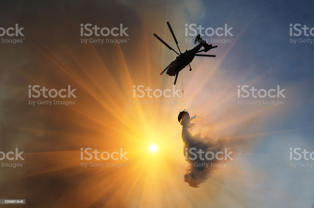 Helicopter waterbombs fire stock photo