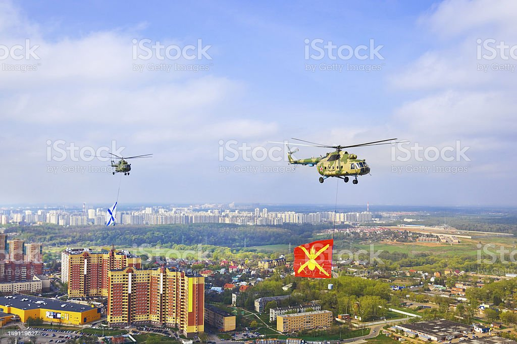 Helicopter with military flag over Moscow at parade of victory royalty-free stock photo
