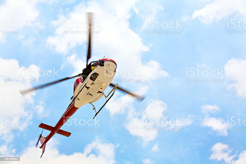 helicopter with pilot stock photo